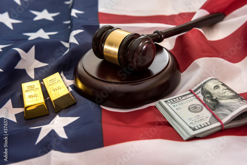 gold bars with justice law hammer lying on usa flag Canvas