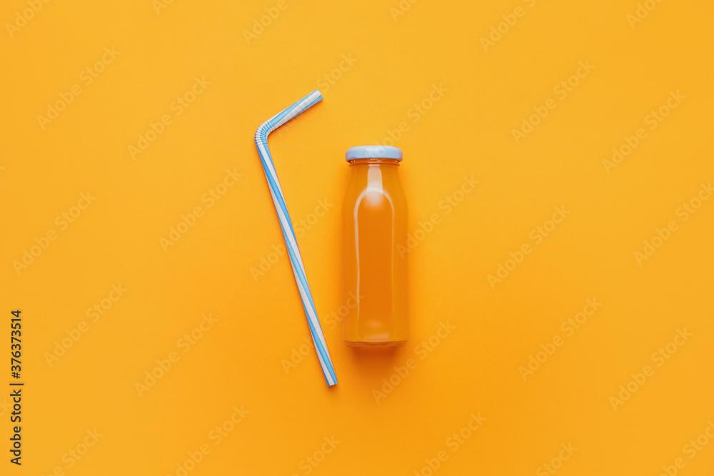 Fototapeta Bottle of juice on color background