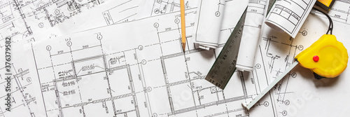 Obraz architect design working drawing sketch plans blueprints and making architectural construction model in architect studio,flat lay. - fototapety do salonu
