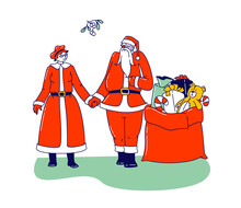 Mr And Mrs Claus Characters. Happy Santa And His Wife Holding Hands And Greeting Under Mistletoe Branch With Gifts Bag