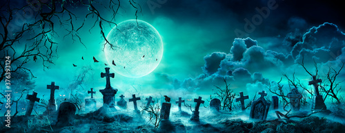 Graveyard At Night - Spooky Cemetery With Moon In Cloudy Sky And Bats  - 376393124