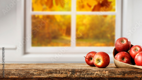 Photographie Fresh red apples on desk and window space