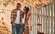 Leinwandbild Motiv Couple in park in autumn
