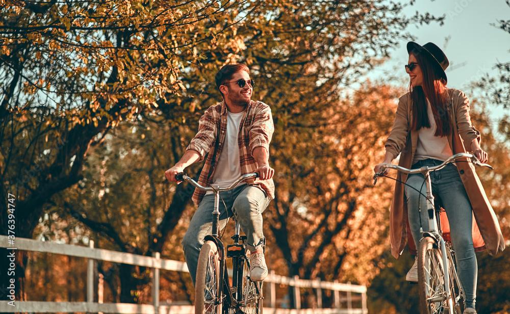 Leinwandbild Motiv - Vasyl : Couple in park in autumn