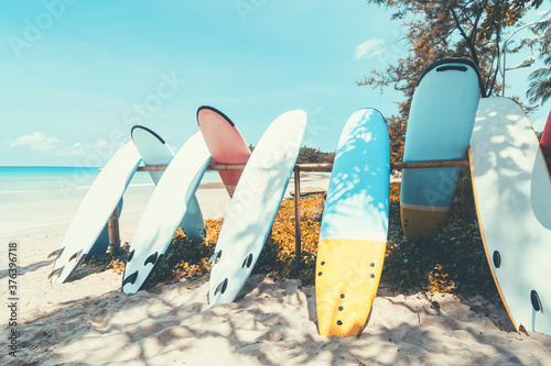 Fototapeta Surfboard on tropical beach with blue sky background