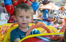 Portrait Of Little Boy In A Merry-go-round
