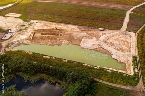Photo Aerial view of fishpond construction site from drone pov