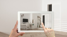 Augmented Reality Concept. Hand Holding Tablet With AR Application Used To Simulate Furniture And Design Products In Empty Interior With Parquet Floor, Modern Children Bedroom