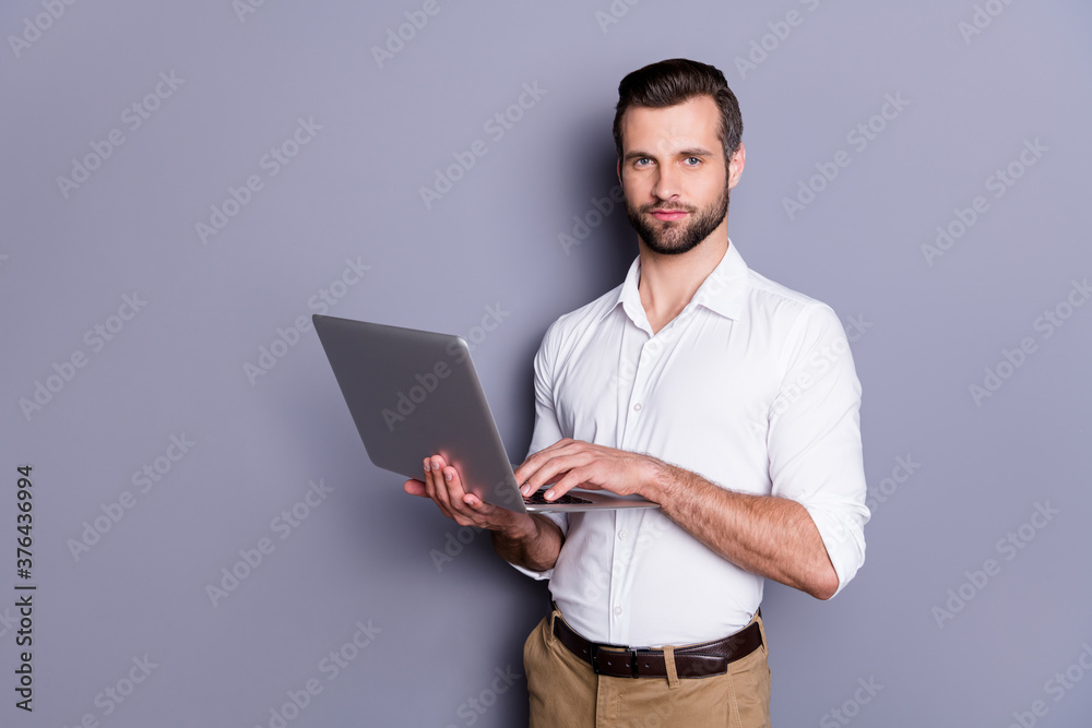 Fototapeta Portrait of his he nice attractive focused skilled brunet guy employer using laptop researching analyzing web market browsing finance report isolated over gray pastel color background