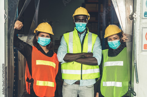 Valokuvatapetti Factory industry worker working with face mask to prevent Covid-19 Coronavirus spreading during job reopening period