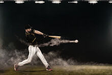 Baseball Player With Bat Taking A Swing On Grand Arena. Ballplayer On Dark Background In Action.