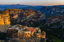 Aerial By Drone Of The Holy Monastery Of Holy Trinity At Sunrise, UNESCO World Heritage Site, Meteora Monasteries