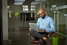 Businessman In A Blue Shirt Si...