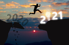Businessman Jumping To 2021 New Year.