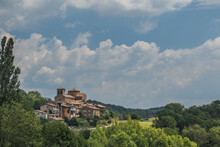Panorama Of A Village Sant Jaume De Frontanya With Church Visible In The Middle. Beautiful Catholic Church In The Middle Of Catalunyan Or Spanish Countryside On A Sunny Day.