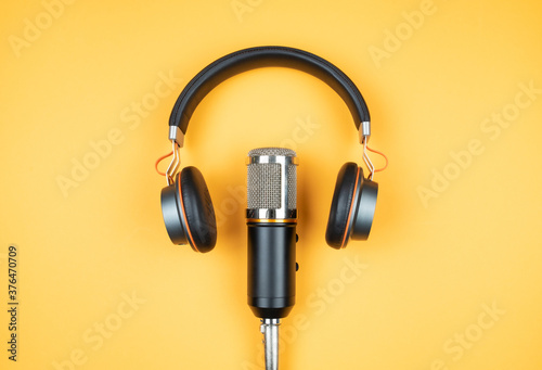 Canvas Print podcasting concept, directly above view of headphones and recording microphone o