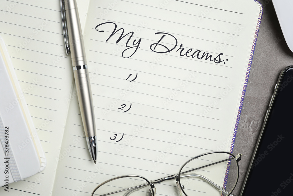 Fototapeta Notebook with dreams list on table, flat lay