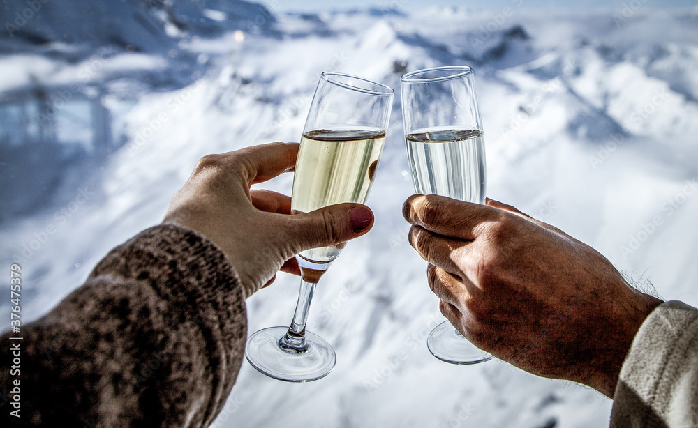 Fototapeta couple drinking champagne and snowy mountains winter holiday