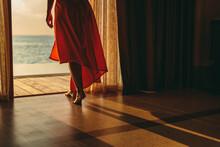 Woman Enjoying Sunset From An ...