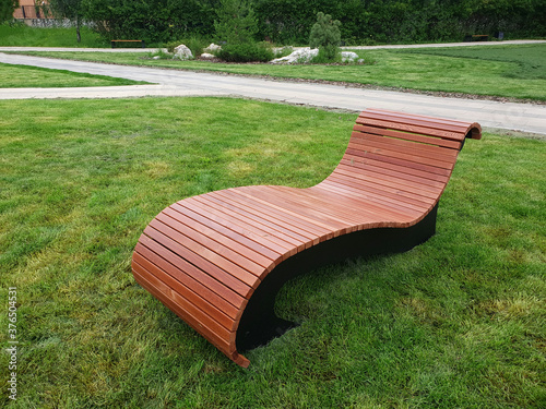 Fotografie, Obraz Wooden lounger for rest in city park in Moscow, Russia