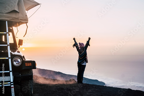 Vászonkép Happy joy people travel with car and tent roof in wild places enjoying the sunse