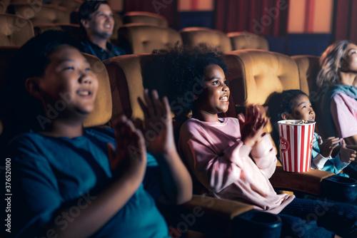 Fototapeta People audience watching movie in the movie theater cinema