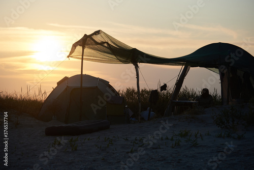 Family vacation in a tent at sunset on sea Canvas