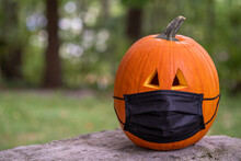 Carved Pumpkin For Halloween Wearing A Covid 19 Face Mask
