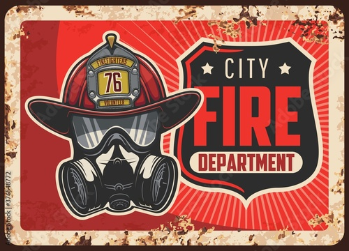 Fototapeta City fire department rusty metal plate. Firefighters helmet or leatherhead with badge, self-contained breathing apparatus or gas mask vector. Emergency situations rescue service retro banner obraz