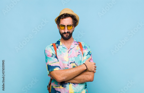 young bearded tourist man feeling sad, upset or angry and looking to the side wi Canvas Print
