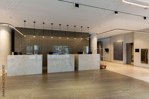 Interior of a hotel lobby with reception desks with transparent covid guards Canvas