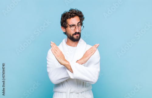 young bearded man wearing a bath robe looking annoyed and sick of your attitude, Wallpaper Mural