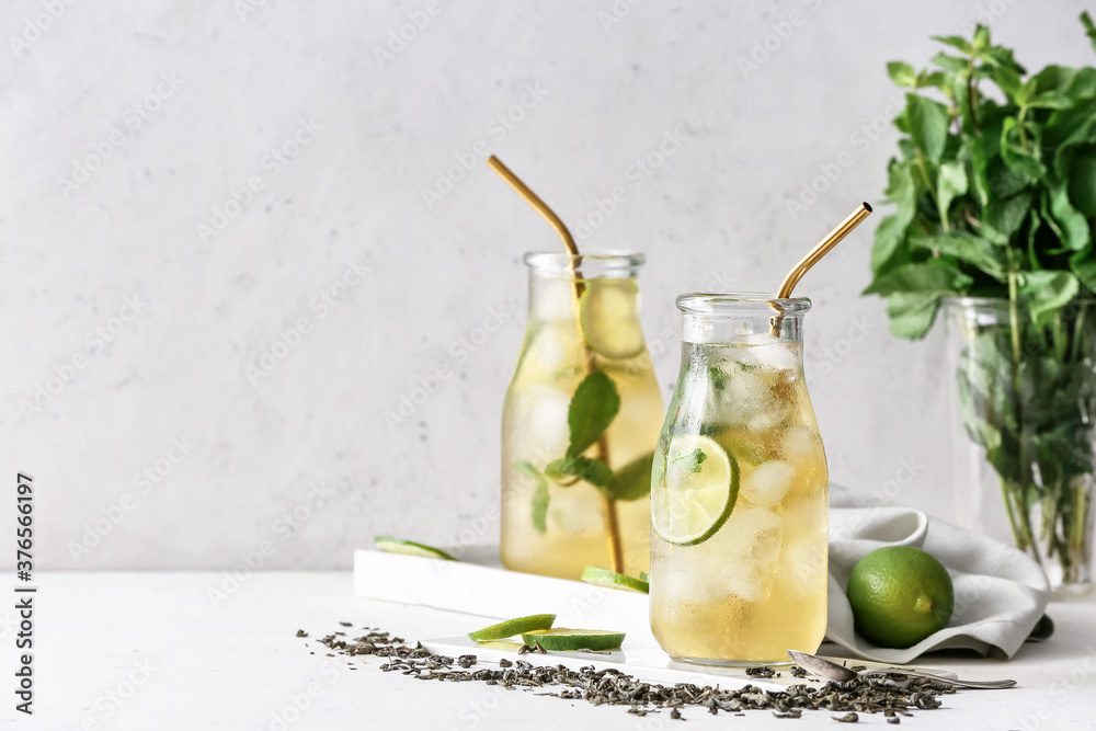Fototapeta Bottles of tasty cold ice tea on table