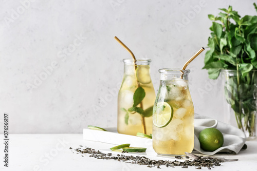 Bottles of tasty cold ice tea on table