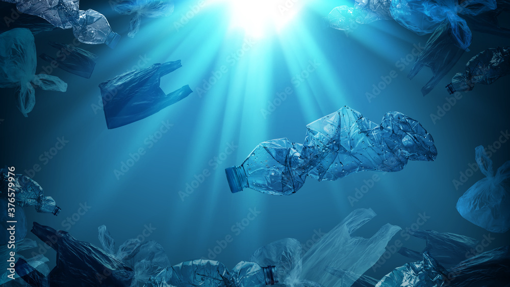 Fototapeta creative background of PET plastic bottles and single-use plastic bags floating in sea or ocean with rays of sunlight effect, polyethylene terephthalate plastic, concept of environmental pollution.