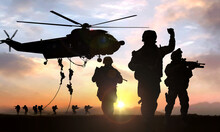 Silhouette  Of Military Operation At Sunset