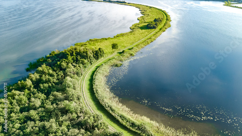 Aerial drone view of path on dam in polder water from above, landscape and natur Slika na platnu