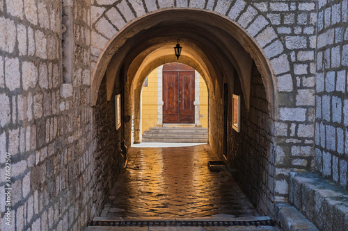 Fototapety, obrazy: Stone gate under the cathedral tower in the old town of Krk on the island of Krk in Croatia