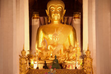 Golden Buddha Statue Inside The Main Chapel Of Wat Phra That Chae Haeng In Nan Province. Thailand