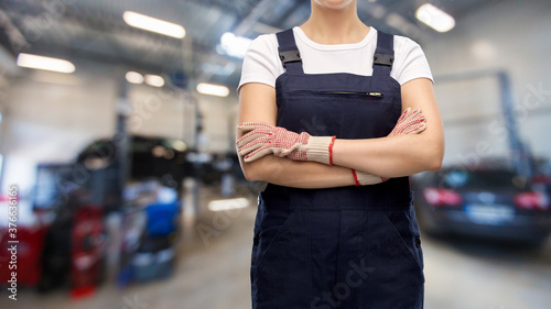 Fotografie, Obraz car service, job and profession concept - close up of female worker in overall a