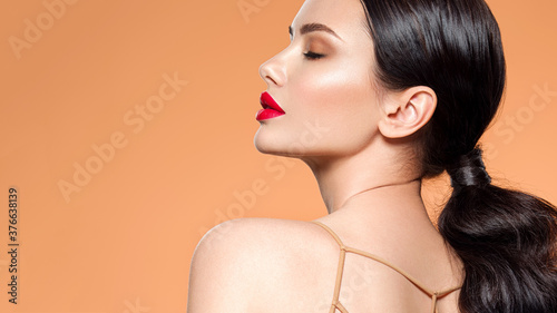 Fotografie, Obraz Beautiful white girl with a red lipstick on lips