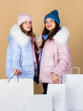 Heavy Bags. Xmas Present. Winter Holidays. Family Vacation. Women In Down Jacket. Girls Shopping Bags. Christmas Shopping Sales. Fun And Gifts. Friendship And Sisterhood. Black Friday. Happy New Year