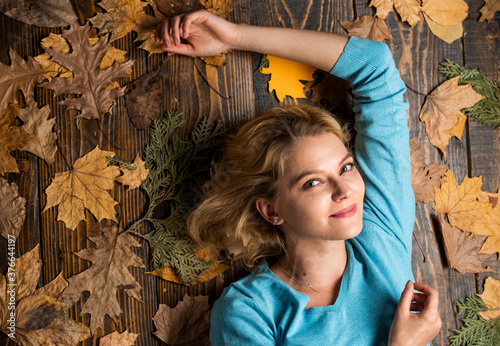 Fototapeta girl relax on autumn background. Beauty in autumn style. Sharing love to nature. Staying beautiful any season. autumn female fashion. Carefree and happy obraz