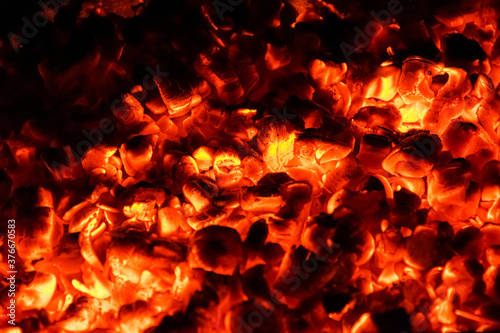 Hot and burning coals in a brazier at night. Wallpaper Mural