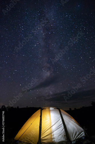 Tent camping under starry night. Fotobehang