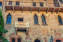 Casa Di Giulietta With Juliet Balcony, Juliet Capulet House Courtyard And Brick Wall Of Building In Verona City Historical Centre Citta Antica, Vintage Retro Style Photo, Veneto Region, Northern Italy