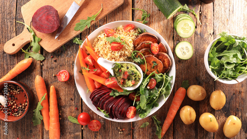 buddha bowl- mixed vegetable salad with beetrool, carrot, sweet potato, lettuce, Fototapet