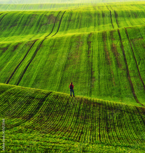 Canvas Print Tourist enjoys the rural landscape. Hills and farmland
