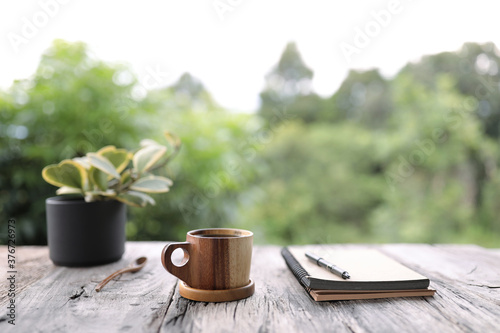 wooden cup made of sweet acacia wood with notebook and plant pot Canvas