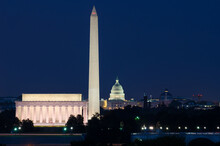 Washington D.C. Skyline At Night With Major Monuments Including  U.S. Capitol And Lincoln Memorial And Washington Monument